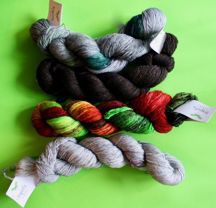 Dragonfly Pixie (fingering weight) yarns in Steel Magnolia, Black Walnut, Chief Black Hawk and Silver Fox