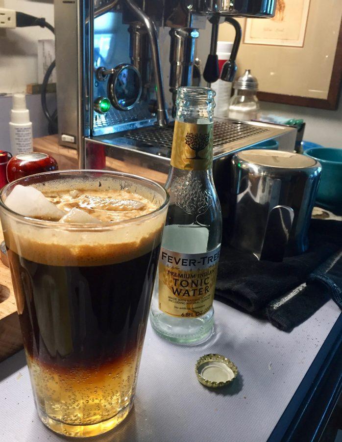 A tall cool glass Espresso Tonic