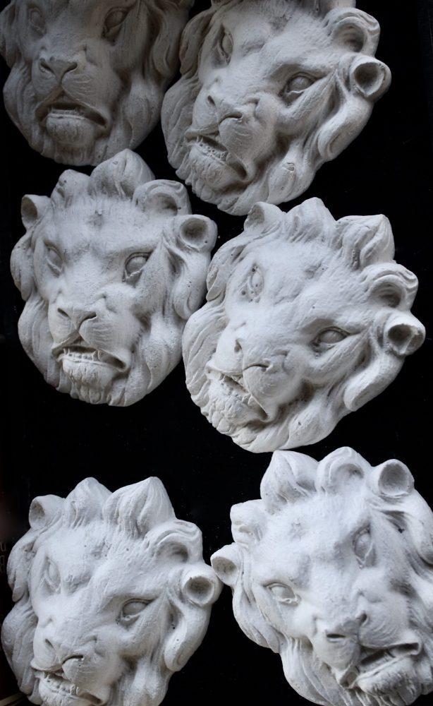 Lion Head Plaques at Flea Market