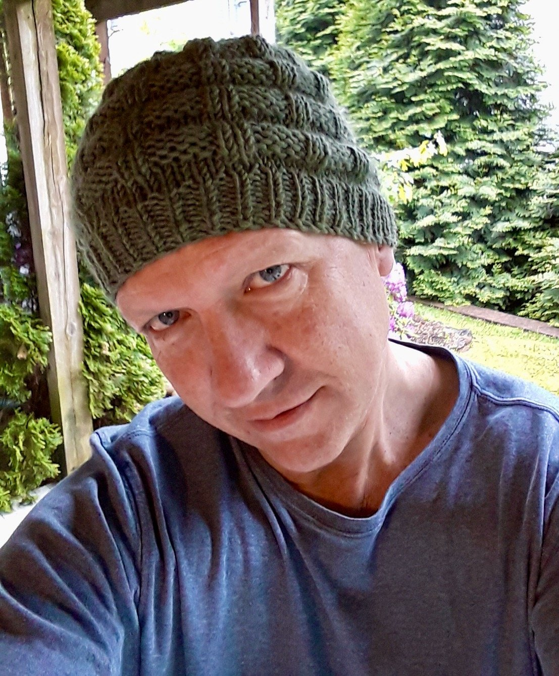 The World stops for a test knit - QueerJoe Wearing Gridditch Beanie 01